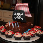 Noah's pirate ship cake and pirate cupcakes made by his Grandmother!